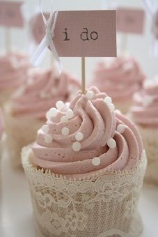 Pretty blush wedding cupcakes with delicate lace cupcake liner cover.