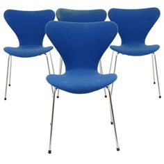 Denmark  20th Century  Set of four Series 7 stacking chairs designed by Arne Jacobsen for Fritz Hansen. Model #3107.Original blue fabric needs to be recovered. Frames are structurally sound with one original rubber foot missing. Labeled underneath the seat with the Fritz Hansen sticker from 1981.
