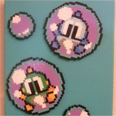Perler beads of Bub and Bob from the game Bubble Bobble.  I loved that game!  Maybe I will have to crochet a blanket or make a quilt in honor of my love for it.