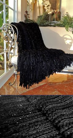"Seriously...A black Afghan? This is probably one of the prettiest ones I've made. All soft, sparkly and pretty! I used a Q-Hook with a combo of different yarns but the body is mostly made with 1 strand of Deborah Norville Serenity Chunky Sequin with another strand of Serenity Chunky plain. Eyelash yarn, boa & a few rows of ruffle yarn to give it some interest. The fringe is 11"" made with about 6 different yarns. I wish if photographed better to show detail. Love it!"