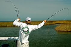 A True Triple. Sight fishing for trophy Redfish with a fly rod in the Biloxi Marsh. New Orleans, LA