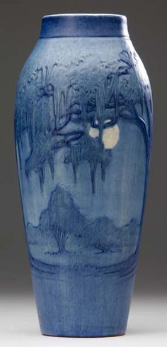 NEWCOMB COLLEGE Tall vase carved by A. F. Simpson with a moonlit landscape of Spanish moss and live oak trees, 1927.