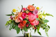 John Huneycutt Photography// colorful summer bridal bouquet- coral charm peonies ranunculus scabiosa billy balls