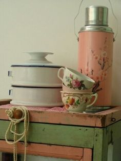 vintage decor... pink and green table with matching pink thermos.