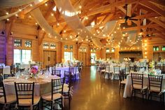 Our venue looks almost identical to this reception hall, except our pavilion is open. The rafters and brick fireplace are the same. I want to hang drapery and lights just like this.