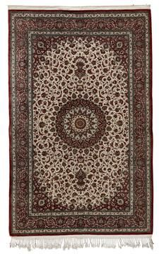 FINE QUM SILK RUG SIGNED ABU QUSAM, CENTRAL PERSIA, LATE 20TH CENTURY the ivory field with rust red and ivory circular medallion, similar spandrels, within rust red arabesque vine border between bands, signature cartouche to one end 202cm x 135cm