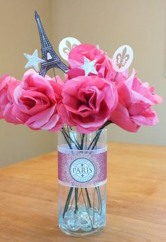Finished DIY vase centerpiece using paris printables. Learn how to create this centerpiece to use with any theme at sparklerparties.c...