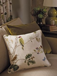 Sanderson Fabric - 'Woodland Chorus' (225511) A green woodpecker, a thrush, butterflies, and various woodland berries adorn the tree.The fabric is digitally printed to achieve the nuances of the artwork and the amount of natural colours and tones in the design.