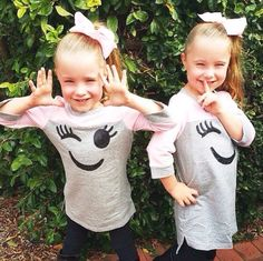 Regram of the adorable @ thehenrytwins in our smiley face dresses!  #pumpkinpatchkids #twins