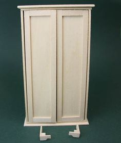 Short lengths of basswood are shaped and glued to form legs for a dolls house scale armoire. - Photo copyright 2010 Lesley Shepherd, Licensed to About.com Inc.