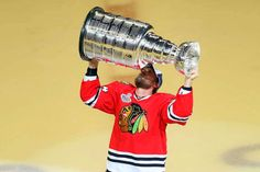 Kimmo Timonen #44 celebrates by hoisting the Stanley Cup