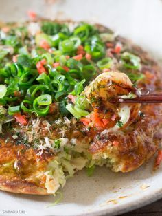 Okonomiyaki: Japanese Savoury Pancakes ~ Plain flour 100g1 eggShredded cabbage 100gFinely chopped/sliced spring onions 1/4 cupPickled ginger 1/2 tbsWater 100mlTenkasu (tempura scraps) 1/4 cupCooking oil 1/2 tbspToppings (what ever you like, suggestions are thin sliced beef,pork, bacon, shrimp etc.)Final Toppings: spring onions, pickled ginger, Okonomiyaki sauce, mayonnaise, bonito flakes
