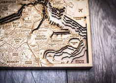 The+Boston+3D+Wood+Map+highlights+favorite+spots+around+the+city+as+well+as+Boston+Harbor.+This+map+will+make+the+perfect+gift+or+collectable+piece+for+any+Beantown+Lover!+Accurate+sea+contours+are+intricately+mapped+in+wood+for+an+awesome+conversation+piece.+Medium+and+Large+sizes+come+with+hang...