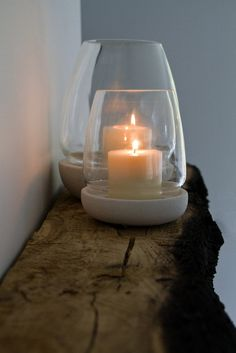These hurricane votives are the perfect addition to any elegant outdoor space. Heavy sandstone textured bases are topped with simple glass to shelter candle flames. Three sizes 4.5h x 3.5dia, 6h x 5dia, 8.5h x 6.75dia.