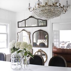 Our dining room is one of my most favorite rooms in our home mainly because it 'reflects' my design style perfectly. (I didn't mean for that to be a punch line but I couldn't resist with all those mirrors.) Mixing the old with the new is what I love to do throughout our home, but this room in particular, shows off my vintage mirror collection and this lovely crystal chandelier, so for me that's why it takes the cake! Have a great Friday & a wonderful weekend, everyone!! #hgtvdesign