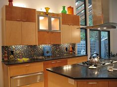 this kitchen makes me think of my grown daughter. It seems bright and colorful but homey too