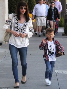 Keeping a close eye: The 43-year-old was dressed casual in jeans and a patterned blouse while enjoying a day out with her son in Beverly Hills on Saturday