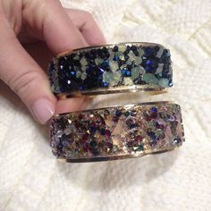 2 Colorful Stone Wide Cuff Bracelet Adjustable wide cuff bracelets. Squeeze to adjust tightness. 1 has pinkish stones and 1 has blue stones. Price is firm. Bundles of 2 or more receive 15% off. So Bundle Up and SAVE!! Jewelry Bracelets