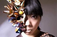 3D sculpture; mask covered in fake butterflies