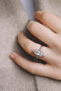 Striking antique French Edwardian cluster vintage engagement ring set with a 1.09 carat marquise-cut diamond surrounded by 14 old mine-cut diamonds with similar diamond shoulders. Set in platinum topped 18K yellow gold. Circa 1915