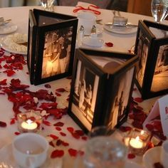 Glue 3 picture frames together with no backs, then place a flameless candle inside to illuminate the photos - awesome centerpiece! - Click image to find more DIY & Crafts Pinterest pins
