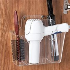 "Hair Stuff Holder - $14.98 The perfect storage solution for those hard-to-store hair essentials! Keep your counters clear by stowing your curling iron, hair dryer, combs, and brushes in this 3-compartment durable acrylic organizer. Mounts on wall or inside cabinet for convenience. 10"" x 5"" x 8 1/4""H."