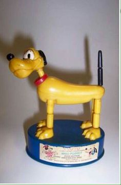 Pluto! Fun little action toy. Push the bottom of box and the legs would wobble.