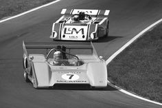 1971 CanAm Champion , Peter Revson in his McLaren M8F , leads Sir Jackie Stewart in his L&M Lola T 260
