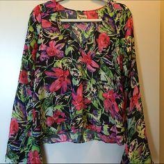 Show Me Your MuMu bell sleeve top Floral print Show Me Your MuMu bell sleeve top in size medium. Show Me Your MuMu Tops