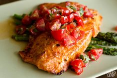 Salmon With Cherry Tomato Salsa And Asparagus  Best Salmon I have every made - most likely part of that had to do with the fact that King Salmon was on sale.