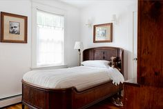 Maryland Farmhouse Bedroom (love the framing - gold antique frames, ecru matting with a sliver of gilt matting next to the black/white print)