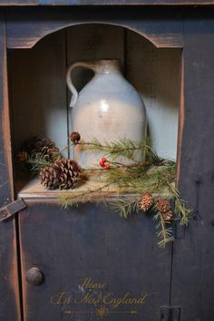 A simple pine branch and pine cone for a beautiful natural rustic Christmas decoration.