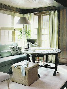 Table and ottoman replace the more common side and coffee table; Bobby McAlpine
