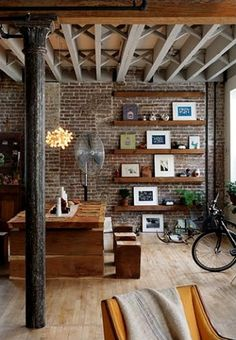 Wooden shelves on brick wall.