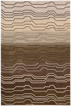 Add a sophisticated splash of color and instant allure to any room with the Contour Nature Brown Rug. An abstract wave pattern makes an arresting style statement when presented in a stunning color palette of white, peach, grey, thistle, and chocolate brown. This charismatic contemporary rug boasts deluxe hand-carved details for an unsurpassed sensuality.
