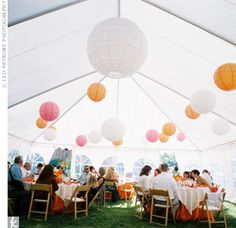 Tess and Brian's intimate reception of 41 guests was held in a large tent near the ceremony site. The decor reflected the bride's passion for bright color. Big paper lanterns and vibrant flowers made the atmosphere fun and casual.