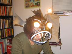 Angler fish!: thinking we could make this out of paper mache or a painted football helmet?