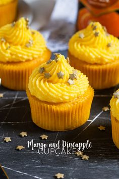 Mango and Pineapple Cupcakes. These soft Mango Cupcakes are filled with crushed pineapple and topped with a light and fluffy mango frosting. Mango Cupcakes, Tropical Cupcakes, Pineapple Cupcakes, Sugar Free Desserts, Cupcake Recipes, Cupcake Cakes, Dessert Recipes, Cup Cakes, Cupcake Ideas