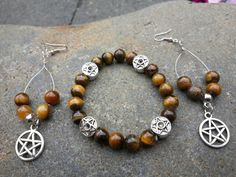Check out this item in my Etsy shop https://www.etsy.com/listing/210172297/tiger-eye-pentagram-earring-and-necklace