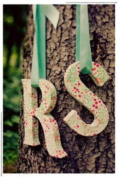 Letters--in the right colors these could be hung behind head table and over arbor, maybe with a heart in between