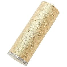 Preowned Boucheron Diamond Gold Platinum Lipstick Case ($2,895) ❤ liked on Polyvore featuring jewelry, multiple, vanity items, 18k gold jewelry, boucheron jewelry, flower jewelry, yellow gold jewelry and 18k jewelry
