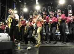 """Mumford and Sons playing with the Austin HS Marching Band at SXSW.  """"Real music for real people."""" (M&S)  It's the brass people. (Aunt Deb)"""