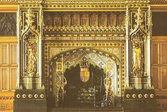 Period hand carved & gilded linenfold panels. Richly hand carved Gothic fireplace surround at the House of Lords, Royal palace of Westminster, England can be reproduced by woodcarversguild.com or chimneypieces-fireplaces.com