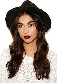 A vampy lip and black fedora create the perfect fall boho vibe