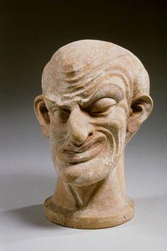 This terracotta head of a man is from Asia Minor (Roman Empire). It problably represents a character from a farce, the 'parasite'. Farces were a popular pastime for the common people. The parasite is insolent and always eats and drinks too much.