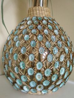 Wouldn't you just love to bring the beauty of the beach inside. Well now you can, with this shell vase hand decorated with the prettiest blue limpet shells. Coastal Decor Rattan Wrapped by lorisartstudio, $120.00