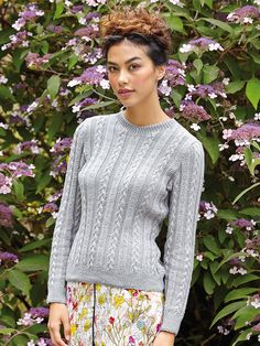 Argentine - Knit this women's cabled and beaded sweater from the Summerlite 4ply Collection, a design by Martin Storey using the gorgeous yarn Summerlite 4ply (cotton). With a high V neck, ribbed cuffs and welt and full length set-in sleeves, this knitting pattern has a two star difficulty rating.