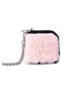 This soft furry pink wallet features a silver metal chain, and black vegan leather interior. - Vegan leather interior - Comes with a silver metal chain - Inside there are 4 card pockets and a pouch fo