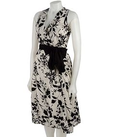 @Overstock - Lapis Botanical Print Wrap Dress - Sleeveless wrap-style dress features bold black and white botanical printLapis wrap dress features sleeveless wrap-style bodice and full skirt with self belt at waistPrinted cotton dress is ideal for daytime wear    http://www.overstock.com/Clothing-Shoes/Lapis-Botanical-Print-Wrap-Dress/2506089/product.html?CID=214117  $47.99