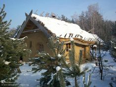 This is a straw bale home built by natural building architect Paulina [www.earthhandsandhouses.org]. The cosy cottage is near Warsaw in Poland. In the winter the wood burning stove warms up the house in just a few hours. The walls are plastered in clay using wheat gluten as a final binding agent for the last coat. In the spring the living roof bursts into life. It's a truly beautiful place to be all year round. More natural homes at www.naturalhomes.org/timeline.htm
